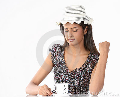 Girl with hat and cup of coffee