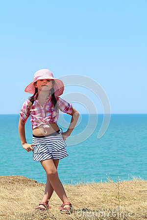 Girl in a hat full length