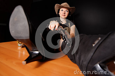 Girl in a hat with a gun