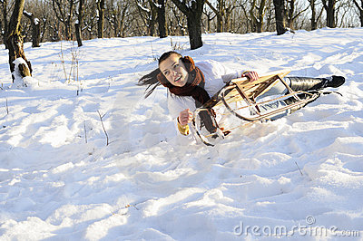 Girl having accident on sledge