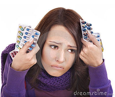 Girl having flu taking pills