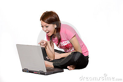 Girl having fun online using laptop