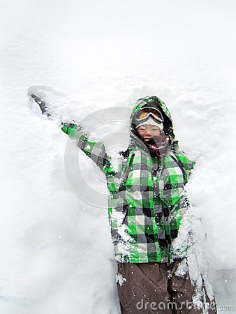 Girl having fun playing snow