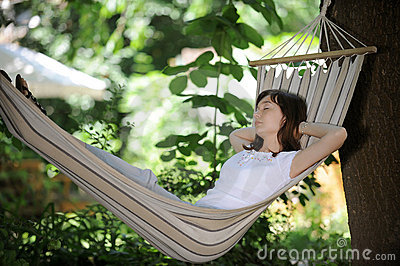 Girl having rest in a hammock