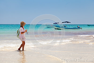 Girl having a walk in Playa Paraiso, Mayan Riviera