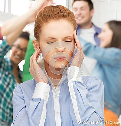 Girl with headache at school