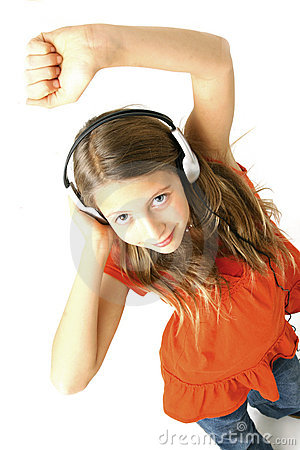 Girl with headphones dancing
