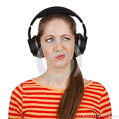 Girl with headphones expresses negative emotions