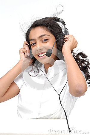A girl with headphones listening to music