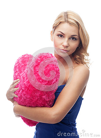 Girl with heart shape pillow
