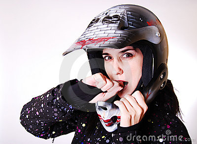 The girl the in a helmet.