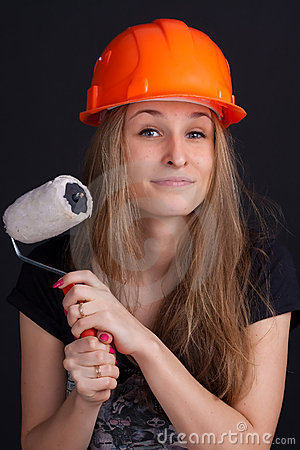 Girl in a helmet with a roller in his hand