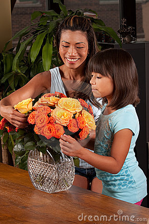 Girl helping mom with flowers
