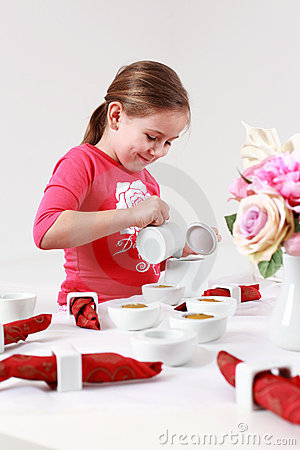 Free Girl Helps To Set Table Royalty Free Stock Image - 18643626
