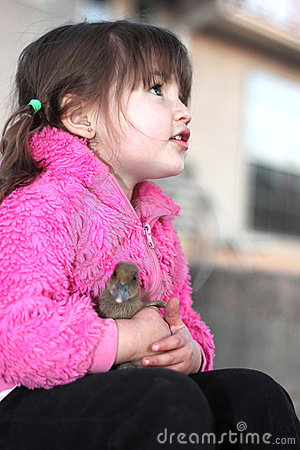 A Girl and Her Baby Duck