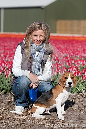 Girl with her dog on flower field