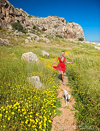 A girl with her dog on a summer path,cyprus
