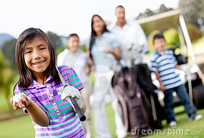 Girl with her family playing golf