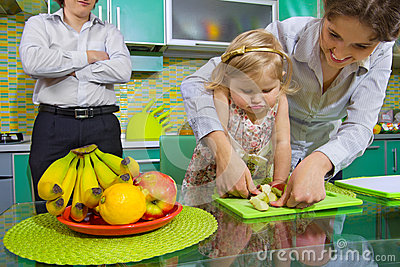 Girl and her mother cutting fruits