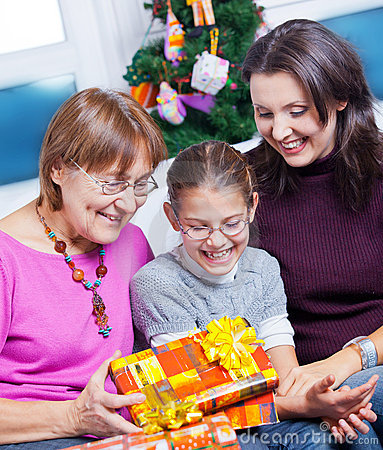 Girl and her mother and grandmother with gifts