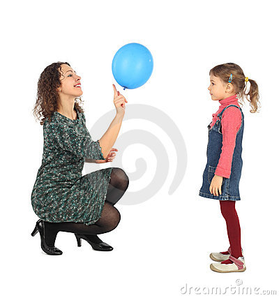 Girl and her mother playing with balloon