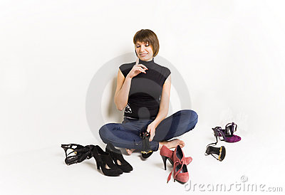 Girl with her shoes, white background