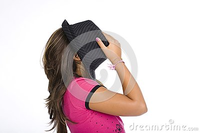 Girl hidding her face with a black hat