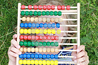 Girl hiding behind an abacus