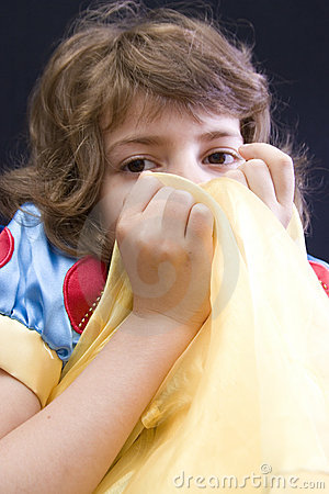 Girl hiding behind fabric