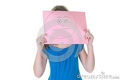 Girl hiding behind fake face - emotional series
