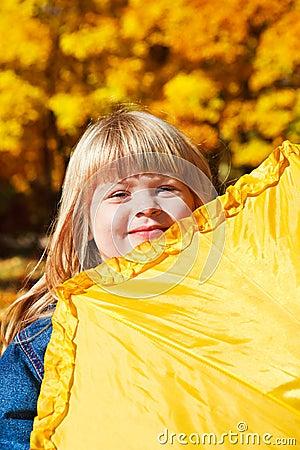 Girl hiding behind  umbrella