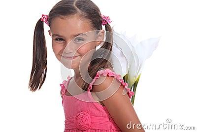 Girl hiding flowers