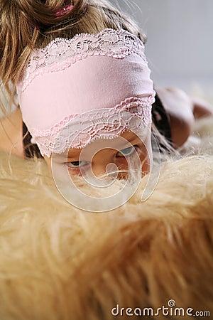 Girl hiding in fur