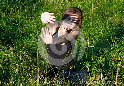 Girl hiding from sun