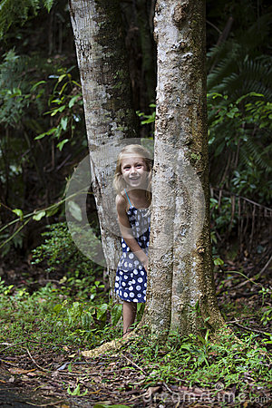 Girl Hiding Between Trees
