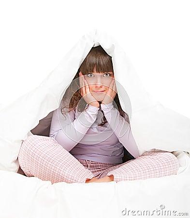 Girl hiding under cover