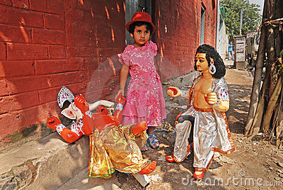 A girl & Hindu Idol. Editorial Photography