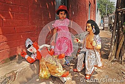 A girl & Hindu Idol. Editorial Photography