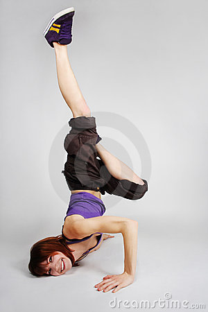 Girl in hip-hop clothes making freeze