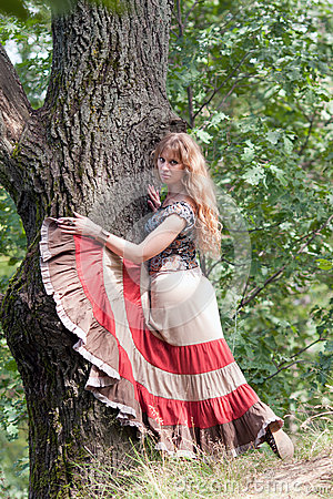 The girl of hippie and a tree