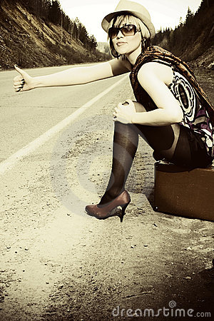 Free Girl Hitchhiking With Suitcase Royalty Free Stock Images - 15236989