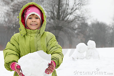 Girl hold of in hands lump of snow