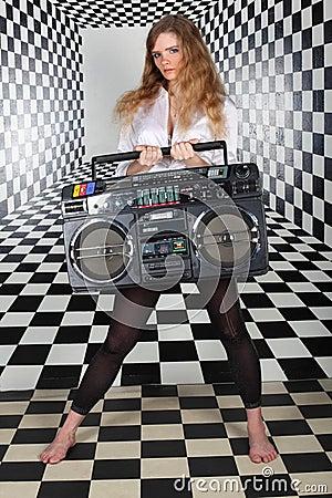 Girl hold old tape cassette recorder