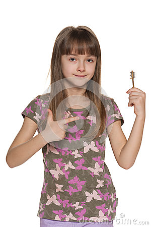 Free Girl Holding A Key To The Apartment Stock Images - 33597014