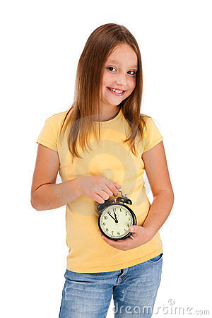 Girl holding alarm-clock isolated on white
