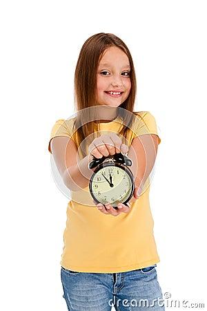 Girl holding alarm-clock isolated on white