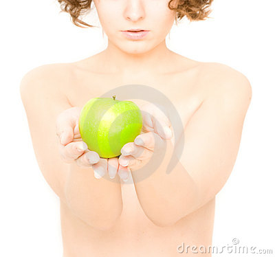 Girl holding an apple (focus on apple)