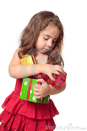 Girl holding an armful of Christmas presents