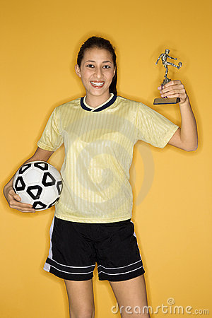 Free Girl Holding Ball And Trophy. Stock Images - 2044314