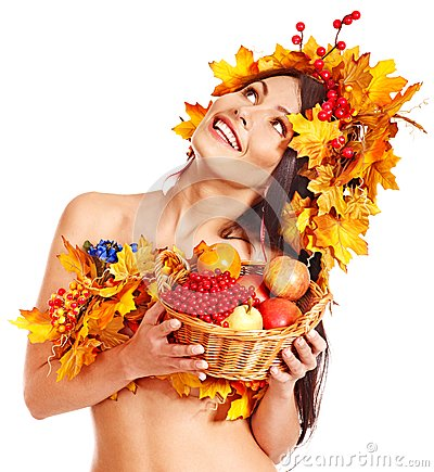 Girl  holding basket with fruit.